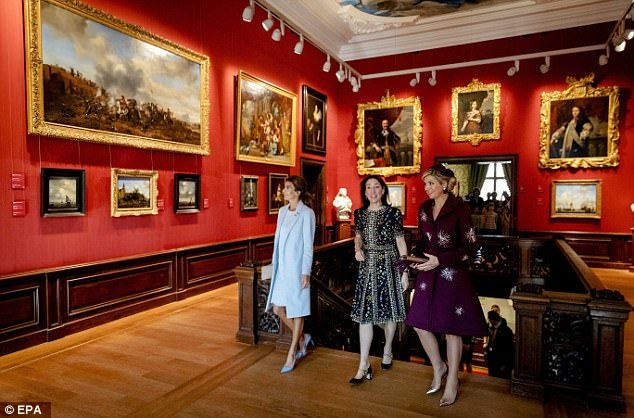 The guests looked fascinated as they were given a tour bymuseum director Emilie E.S. Gordenker