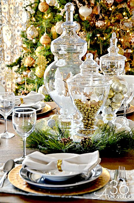 Glass, gold and greenery combine with white to create an elegant tablescape, as perfect for New Year's Eve as it is for christmas Eve...