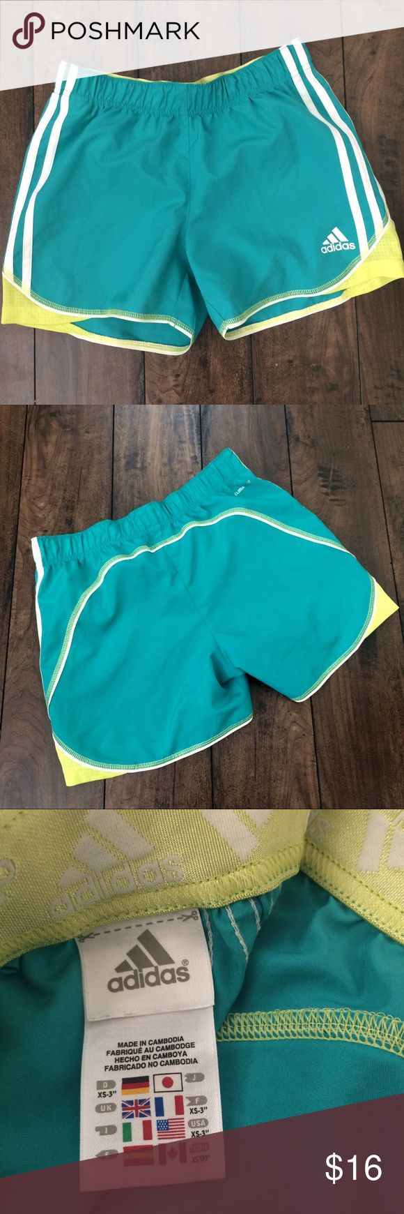 "Adidas Climalite Teal Shorts Lightweight and beautiful color combo of teal/white/chartreuse shorts make these perfect for a quick workout. No pockets on these shorts and they are made from 100% polyester. Measurements laying flat are approximately 13"" waistband and 12"" length laying flat. Adidas Shorts"