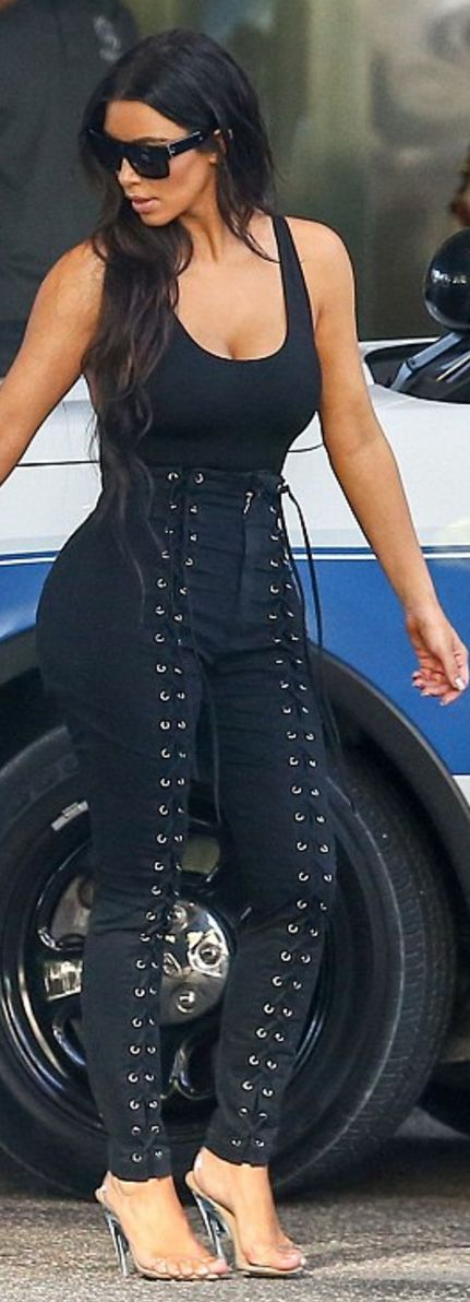 Who made Kim Kardashian's clear sandals, black lace up pants, tank top, and sunglasses?