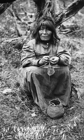 Native American woman knitting. 1930.