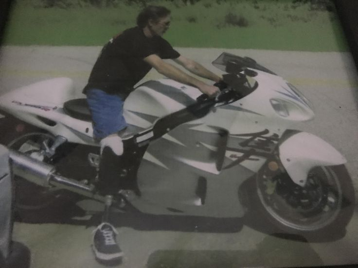 Sorry for the terrible photo but this is my dad in 2006 riding my Suzuki gsxr 1300 (hayabusa) on that day he just hit his 1yr mark being a double amputee. By far the bravest man Ive ever known