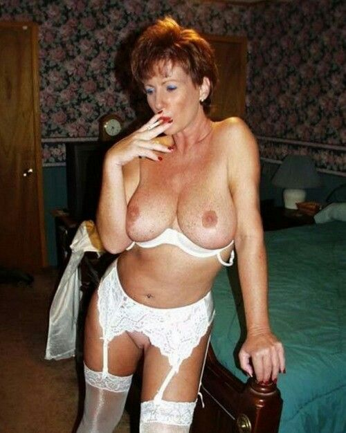 Brunette shows tits someone in room