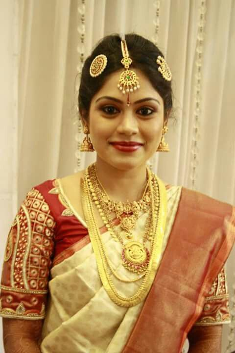 South Indian bride. Temple jewelry. Jhumki.Cream silk kanchipuram sari.Braid with fresh flowers. Tamil bride. Telugu bride. Kannada bride. Hindu bride. Malayalee bride.South Indian wedding.