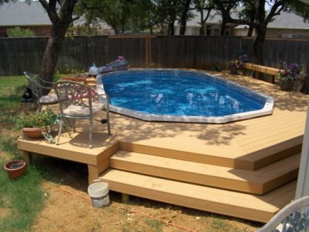 Semi in ground http://www.abovegroundpoolbuilder.com/pool-deck-ideas-for-everyone