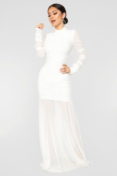 1850c3b58b Winter Wedding Dresses Fit For An Ice Queen. Brunette woman in white gown  standing in grey room