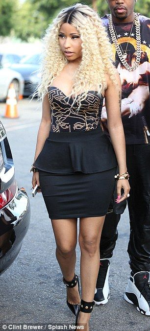 Dressed to impress: Nicki Minaj looks just as good with her clothes on, as she proved while arriving to film Chris Brown's new music video last week - Visit www.styleopath.com for a chance to win £200 worth of luxury afro hair products. ~Visit: http://styleopath.com