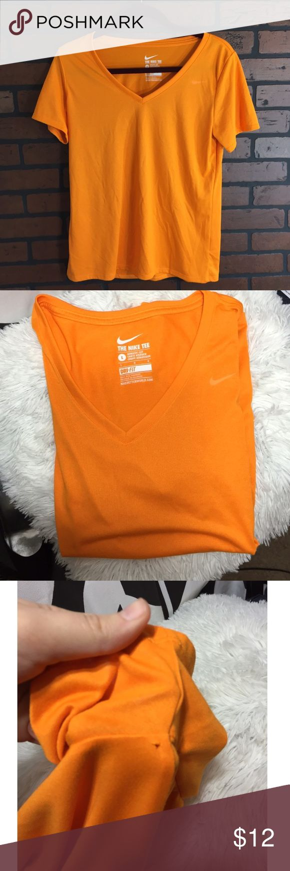 Women's Nike Workout Tee Women's size large, orange workout tee. Dri fit. Excellent condition, only flaw is a pull under the left armpit which isn't noticeable when worn. Nike Tops Tees - Short Sleeve
