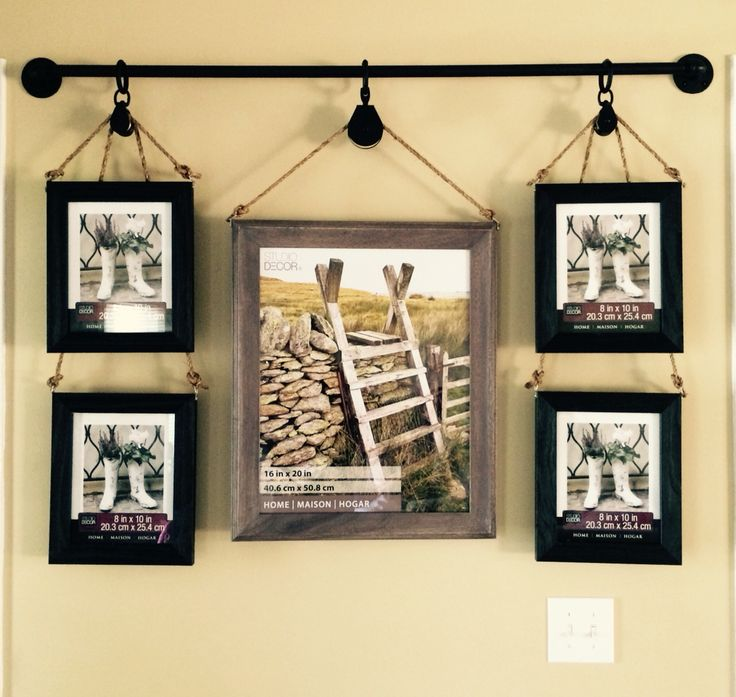"I saw a lot of great ideas but I came up with the idea of using dual pulleys. After hanging picture frames from 1/2"" pipe and flanges...it became a masterpiece!"