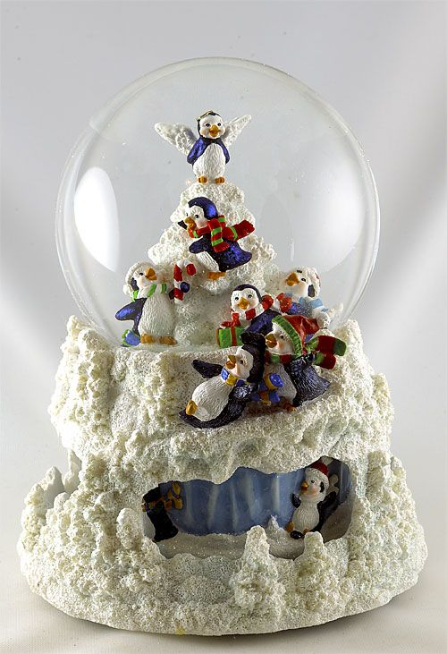 $ 79.00Music choice: Let It Snow 'LET IT SNOW' is the wonderful song this music box plays as you watch the fun these penguins are having... Penguin with Tree Rotating 100mm glittery Snow Globe... 7 x 5 inches