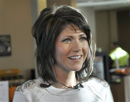 Kristi Noem's style:: it can creep shorter or longer without hubby's notice, maybe?