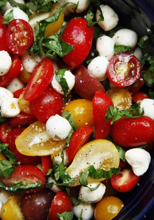 caprese salad. with colorful tomatoes.  One of my FAV salads!! It is yummo