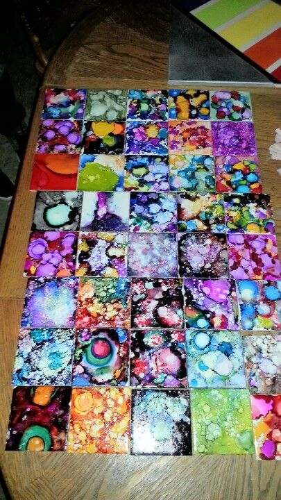 Alcohol ink coaster. Just plain while ceramic tiles, rubbing alcohol and special alcohol ink from any craft store. Would make an awesome new bathroom floor! http://www.etsy.com/shop/KaleidoscopeRoot