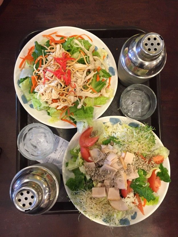 We placed our order for the two salads most frequently seen on the show — a Chinese chicken salad (on top) plus a chef salad (on bottom), along with two Mango Greentinis. | We Tried The Salads The Kardashians Are Always Eating On Their Show