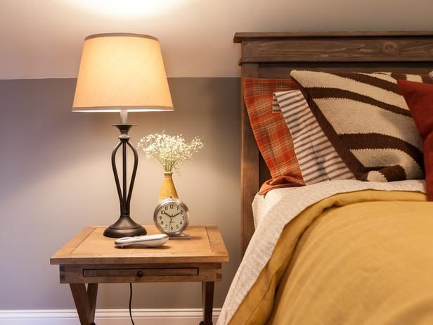 A Cross Leg Nightstand Provides Tabletop Surface To Display A Rustic Chic  Lamp,