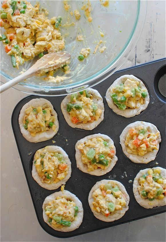 Chicken Pot Pie Cupcakes Two cans Pillsbury biscuits, a cup cooked and diced chicken breast, one can cream of chicken soup, some shredded cheddar, frozen mixed veggies, some Herbs De Provence, onion powder and garlic salt. Dump everything into a bowl. (minus the biscuits.) Press your biscuits into a muffin tin, spoon the filling in Bake at 400 about 15 minutes.