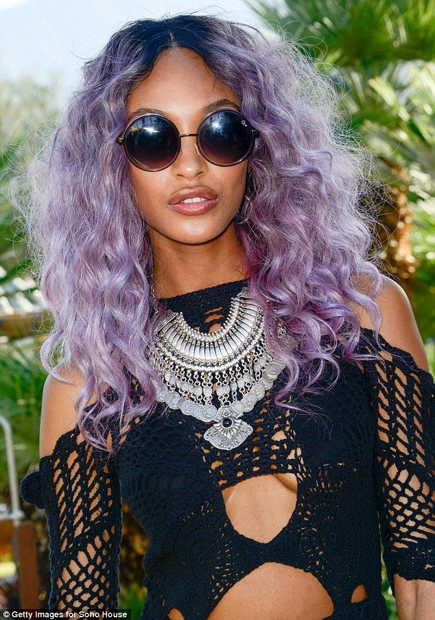Bold: She teamed her new purple tresses with a bold playsuit, which featured cut-outs at her bosom