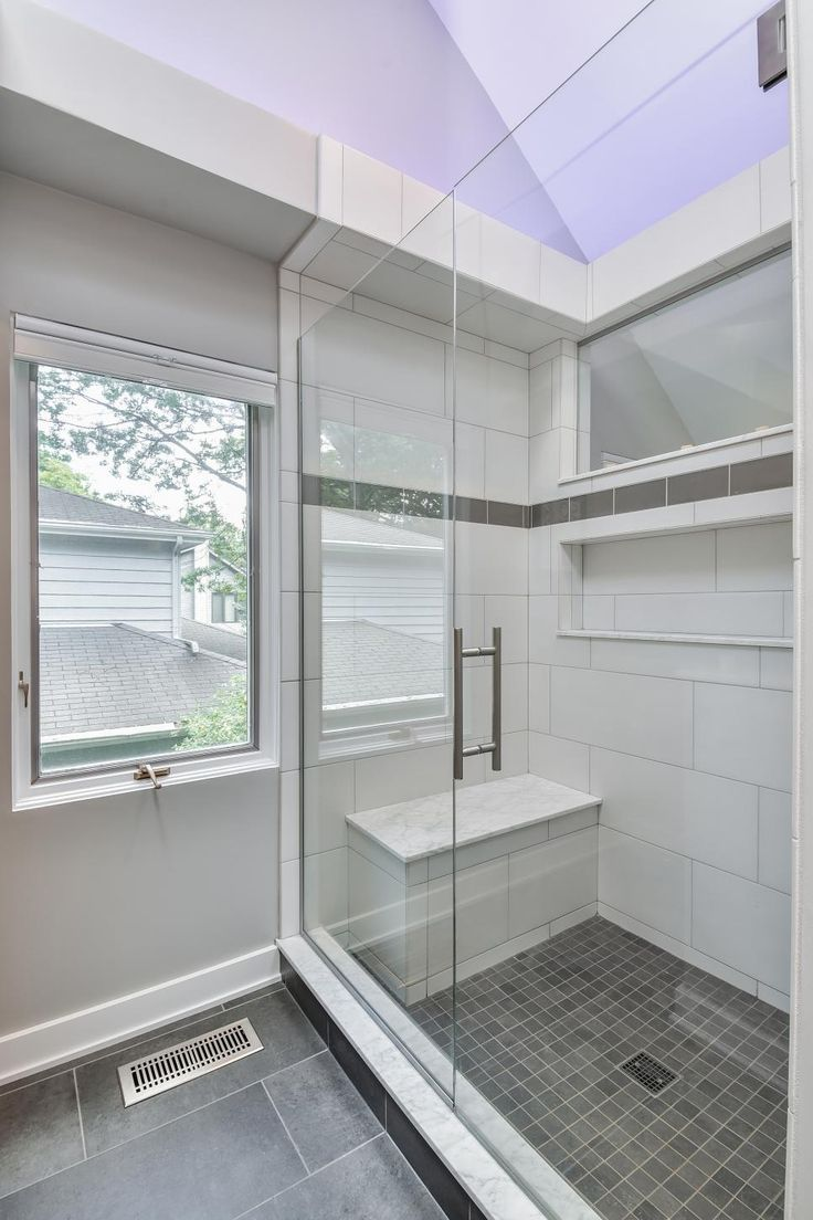Blending In With The White Subway Tile, A Built In Shower Bench Brings A
