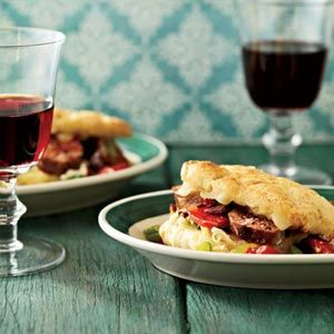 Italian Sausage-and-Fontina Biscuit Sandwiches - These cheesy breakfast biscuits, stuffed with Italian sausage and veggies, make a satisfying first meal, whether you're sitting down to brunch with the family or taking them on the go.