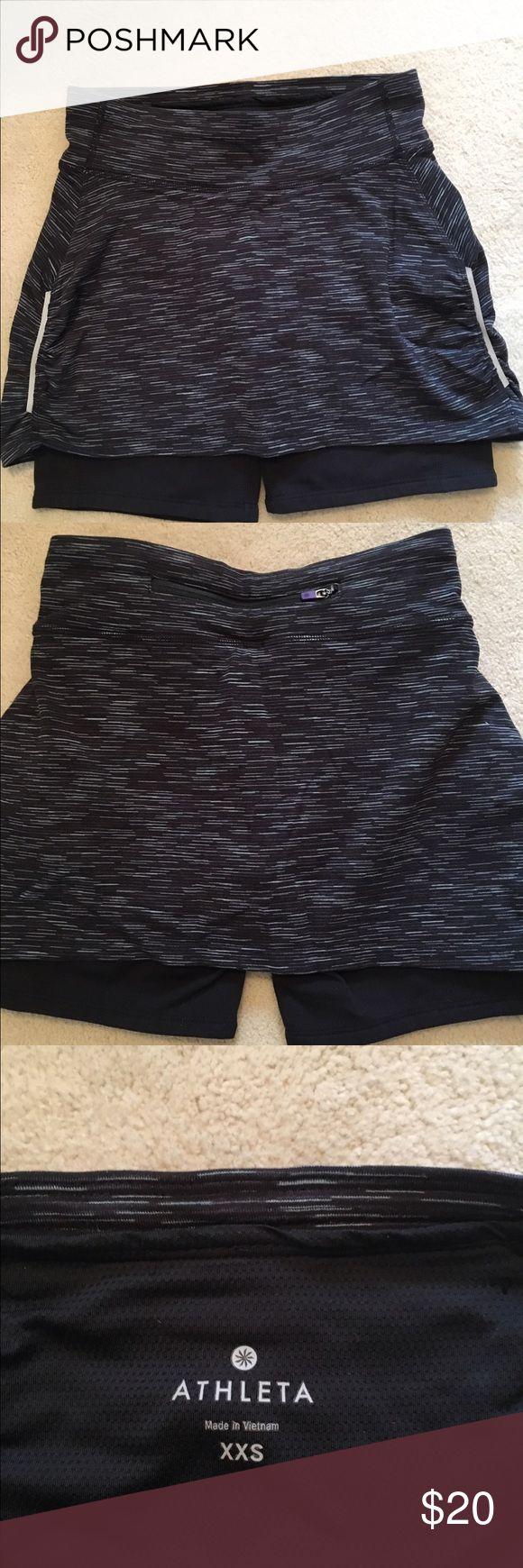 Athleta sport skirt w/ bike shorts, xxs, like new Great for tennis, running, etc.  Size xxs,  worn couple times but no longer fits.  Has zip pocket in back.  Like new condition. Athleta Shorts Skorts