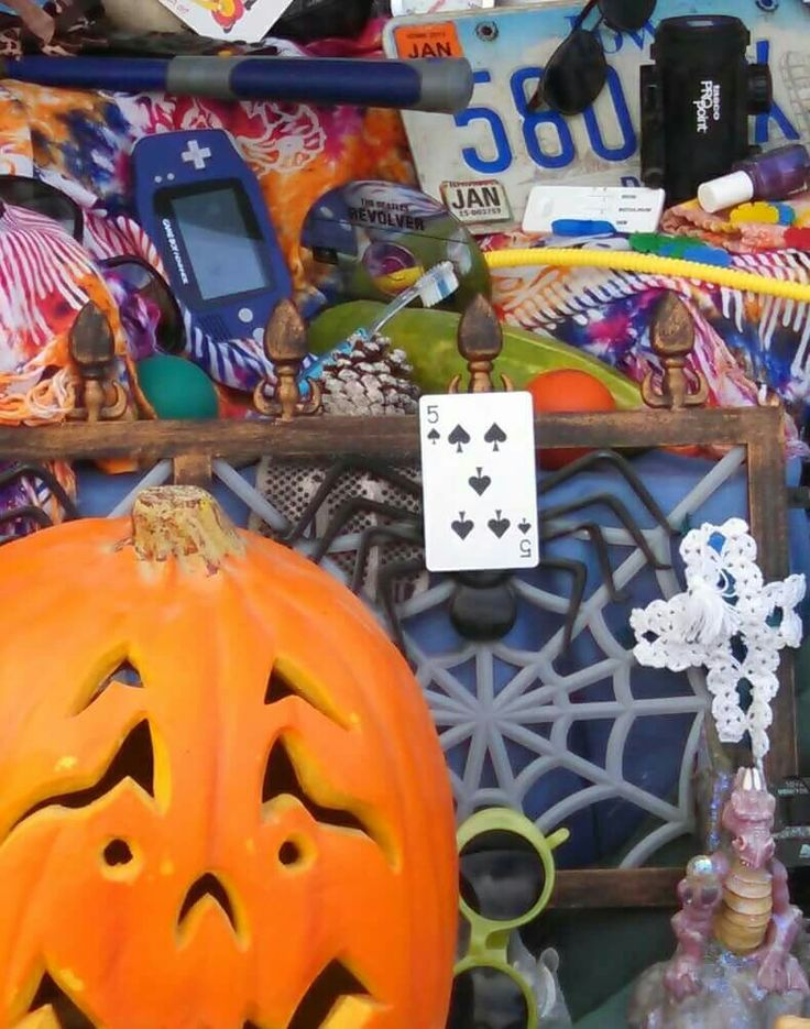 I SPY themed Trunk or Treat. Fill your trunk with random items. On index cards, write things that kids can search for.  ie; 2 frogs, 4 playing cards, 3 dice. Make a set for younger kids and a set for older kids. I did this last year (2015) and the kids LOVED IT. It was so fun and very interactive!