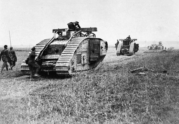 British tanks pass dead Germans who were alive before the cavalry advanced a few minutes before the picture was taken. World War I saw the debut of tank warfare, with varying levels of success, mostly poor. Many of the earlier models broke down frequently, or got bogged down in mud, fell into trenches, or, (slow-moving) were directly targeted by artillery.