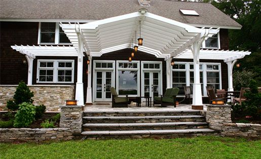 Craftsman Style Pergola with Shade Cloth - This structure, a successful collaborative effort with the client, incorporates many facets of a pergola into a unified, functional whole.