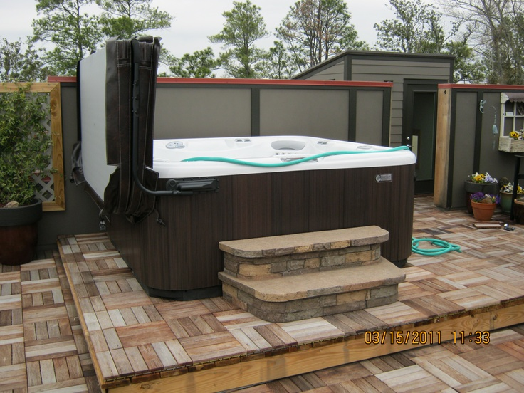 This hot spring spa is shown in espresso with natural for Hot tub designs and layouts