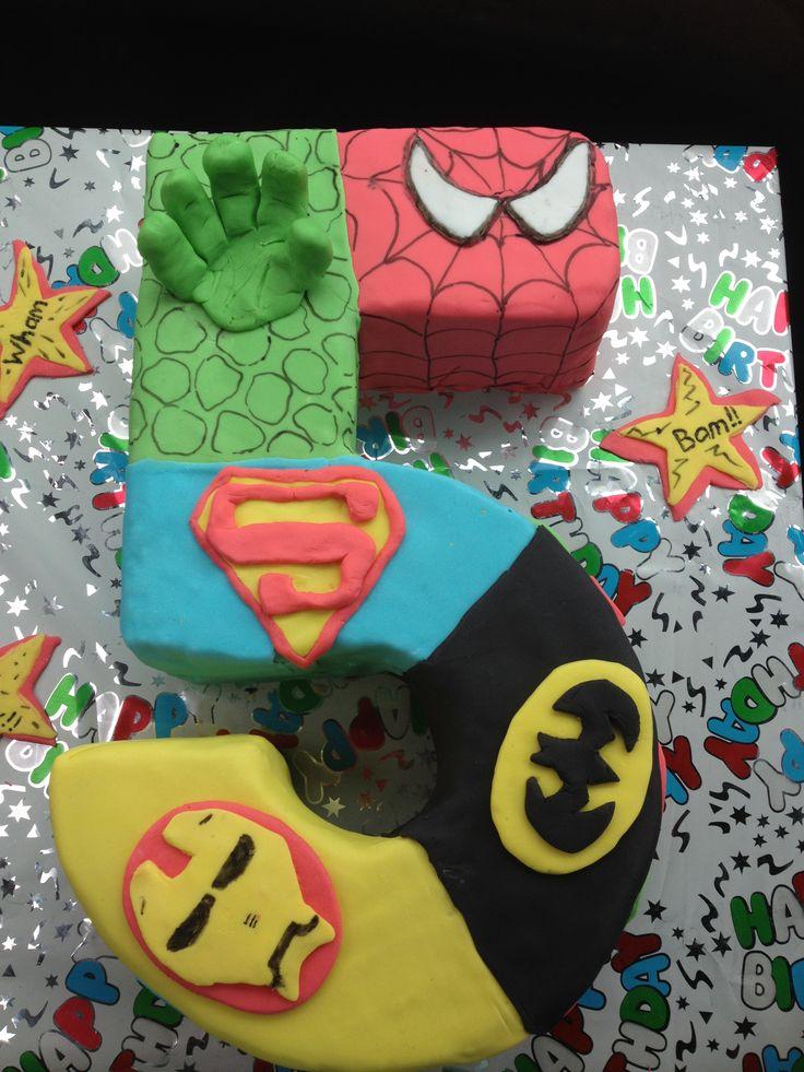 My son's super hero cake I made ; double layer caramel mud , caramel frosting , fondant covered - number 5 cake with 5 super hero's ( spiderman , hulk, superman, batman, ironman) for my super 5 yo boy !!!