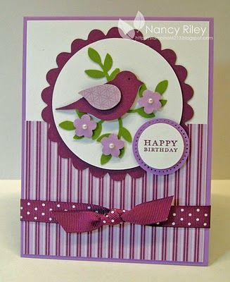 handmade card from i STAMP by Nancy Riley ...two step bird punch .,,, luv the whole layout of this card ... scalloped edged circle holds bird on punched branches with punched flowers ... ribbon knotted ... Rich Razzleberry and Orchid Opulence ,,. lovely ... Stampin' Up!