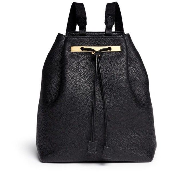 The Row Grainy leather drawstring bucket backpack (34.487.470 IDR) ❤ liked on Polyvore featuring bags, backpacks, backpack, black, leather bags, genuine leather backpack, black drawstring backpack, black bucket bag and black rucksack