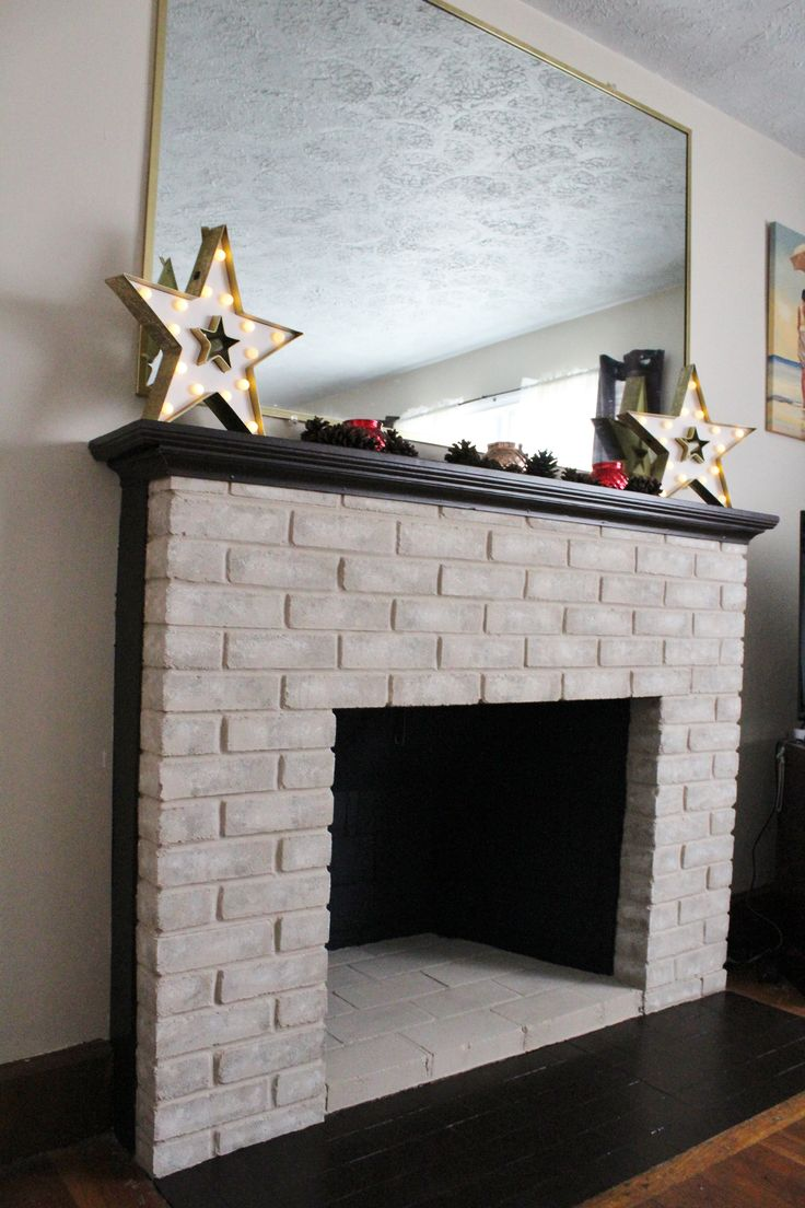 Fireplace makeover with painted mantel and hearth. Color: Sweet Molasses by Behr. @behrpaint