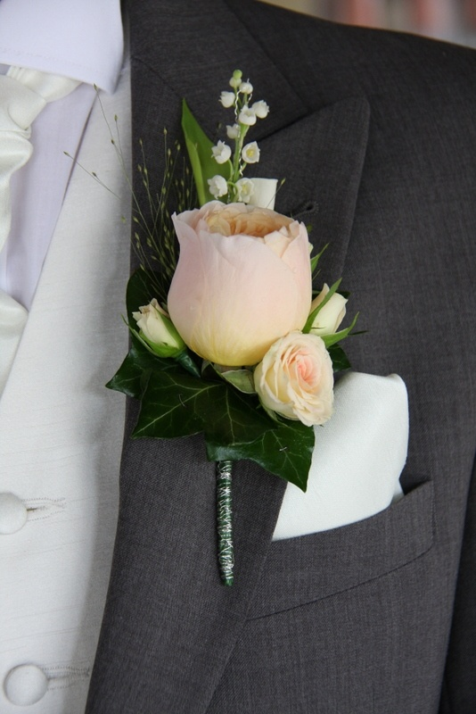 The Bride Groom's rather special Boutonniere of scented Lily of the Valley, Champagne Grass, rolled Vendella Rose Petals, tiny Gracia Creme Rose buds and the exquisite Rose Juliet