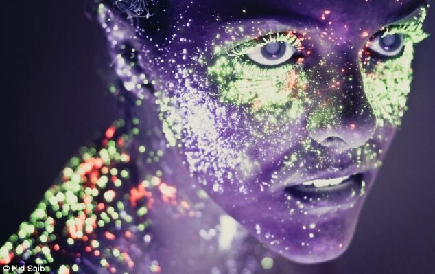 Other worldly: Glittering under ultra violet light a model is given an unearthly glow in this photograph by Hid Saib