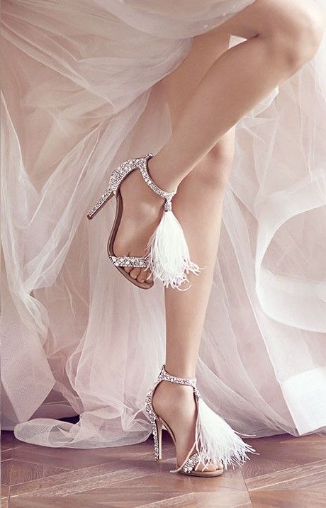 VIOLA 110  $1,875.00  White Suede and Hot Fix Crystal Embellished Sandals with an Ostrich Feather Tassel