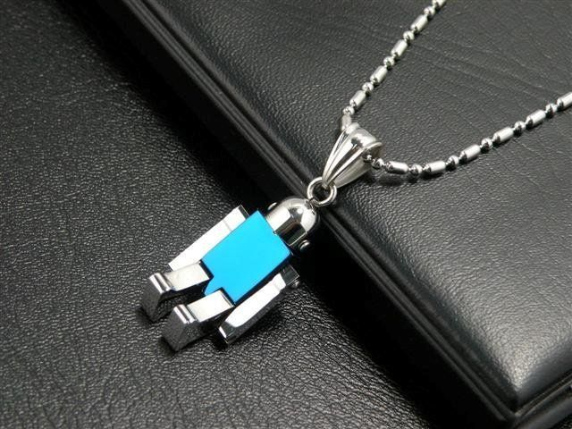 Little Stainless Steel and Blue IP Robot Pendant with free moving arms and legs. http://lily316.com.au/shop/ladies/unisex-stainless-steel-and-ip-robot-pendant/