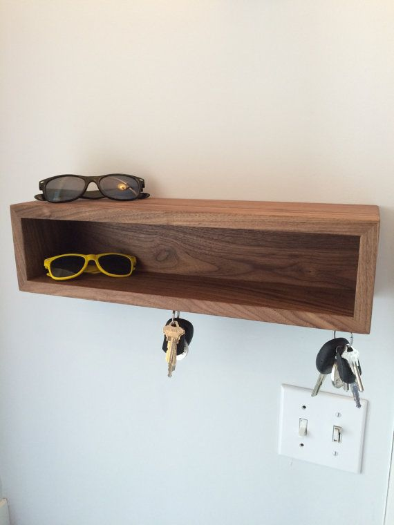 Entryway floating shelves with magnetic key hooks  Our Floating Entryway Shelf is built from a single hardwood board showing a continuous grain and consistent color. Available in 3 lengths, and your choice of 3 hardwoods (walnut, white oak or ash)