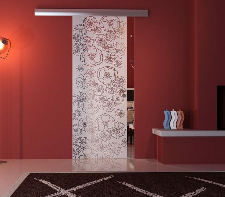 porta in vetro acidato, stratificato e temperato con lavorazione traslucida. Sistema scorrevole in alluminio http://www.portebelle.com