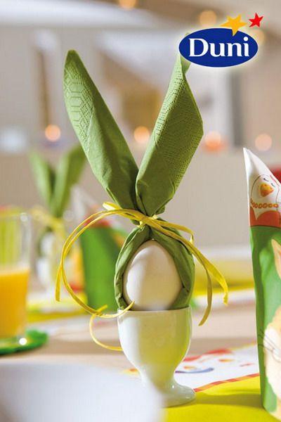 green napkin rolledinto bunny