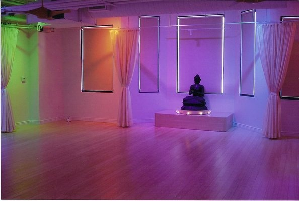 Really colorful yoga studio space, lit by LED lighting...