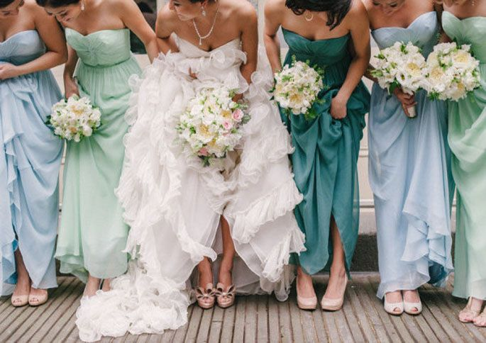 Such a pretty mix of blue and green bridesmaids dresses. Same dress, different shades/colors.