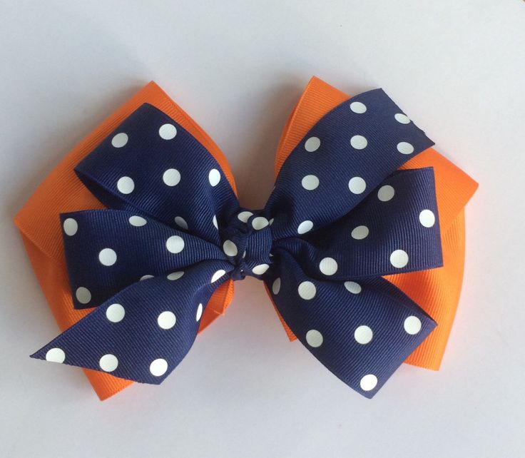 A personal favorite from my Etsy shop https://www.etsy.com/listing/241000698/large-auburn-game-day-hair-bow-auburn
