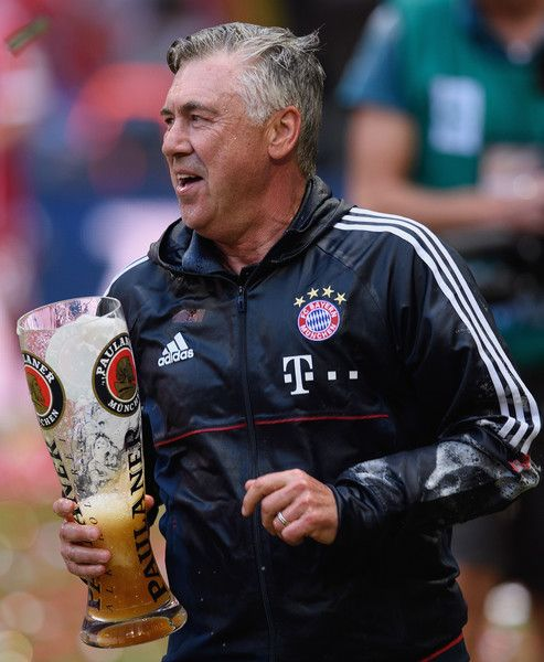 Carlo Ancelotti, Manager of Bayern Muenchen is showered in beer by his players following the Bundesliga match between Bayern Muenchen and SC Freiburg at Allianz Arena on May 20, 2017 in Munich, Germany.