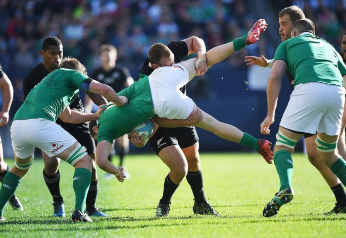 New Zealand's Joe Moody spear tackles Robbie Henshaw of Ireland, resulting in a yellow card. Photo: Andrew Cornaga/Inpho