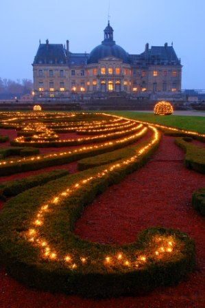 17th century Vaux Le Vicomte chateau outside Paris - summertime candlelight nights in which chateau and gardens are lit only by candlelight