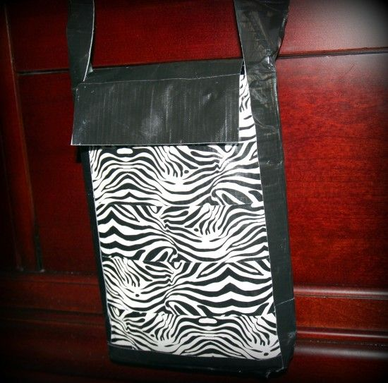 How To Make a Duct Tape Purse  ~ They turned out beautifully and the girls LOVED them.  This is a great craft for tweens and teenage girls!