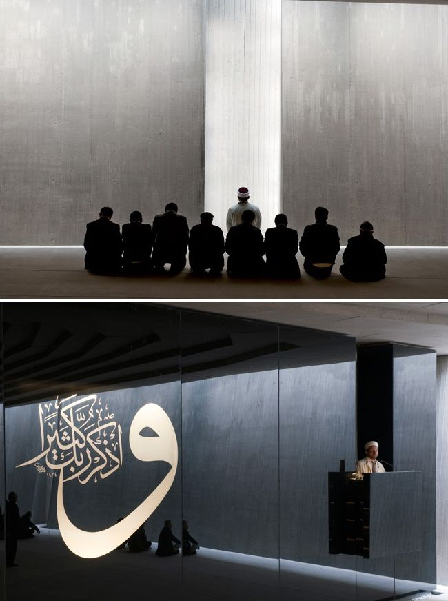 Imam leads prayers and delivers a sermon in Sancaklar Mosque, Istanbul.  Designed by Emre Arolat Architects (EAA) and built in 2011.  Photos by Thomas Mayer.