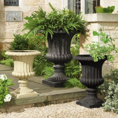 Grecian Urns.  I love to garden and boost our home's curb appeal with a planter full of colorful flowers and cascading ivies!