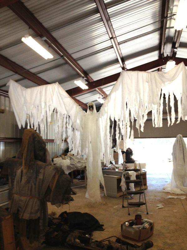 My friend and I are working hard on props for our haunted trail this year.Here is our latest. He was so huge we had to suspend him from the roof to apply the fabric. The best thing about him is that he was very inexpensive.The white material came from the local furniture stores and we had the PVC on hand from last year. I purchased the large skull at Michaels last year for $5 with a 40 % off coupon. We spent about $4 for the PVC elbows and that was all it cost us this year.