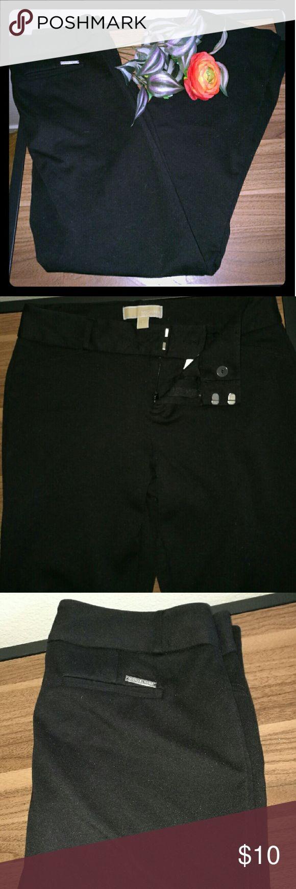 Michael Kors Skinny Pants/Leggings Black skinny pants. They fit like leggings but button like pants. Double tab, button, zip closure. Very stretchy, so they may fit the next size up. MICHAEL Michael Kors Pants Skinny